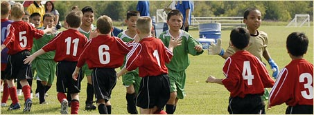 Kids showing sportsmanship after a game
